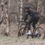 woman riding bicycle near trees