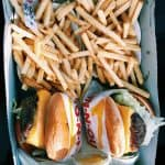 burgers and fries inside box